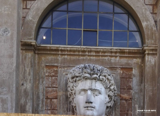 """Head of a Colossal Roman Statue of Emperor Augustus (1st century AD) in the Courtyard of the """"Pigna"""", Vatican"""