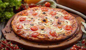 Capricciosa - tomato sauce, mozzarella, ham, mushrooms, artichokes, olives