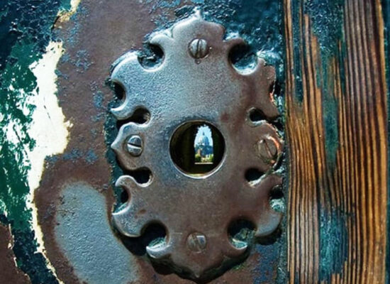 Keyhole in the doors of the Priory of the Knights of Malta, Piazza of Knights of Malta, Aventine Hill. Through the keyhole the panorama of three countries - Italy, Vatican and the Order of Malta can be observed.
