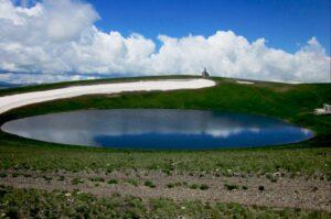 Lake near Extinct Volcano Armagan (2829 m) and Church