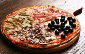 Quattro stagioni - tomato sauce, mozzarella, ham, mushrooms, artichokes, olives