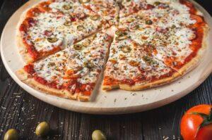 Siciliana - tomato sauce, mozzarella, capers, anchovies, olives