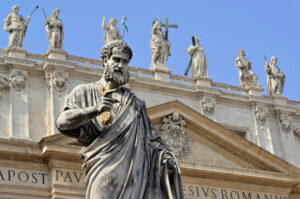 St. Peter and Statues of Jesus and the Apostles on top of St. Peter's Basilica.