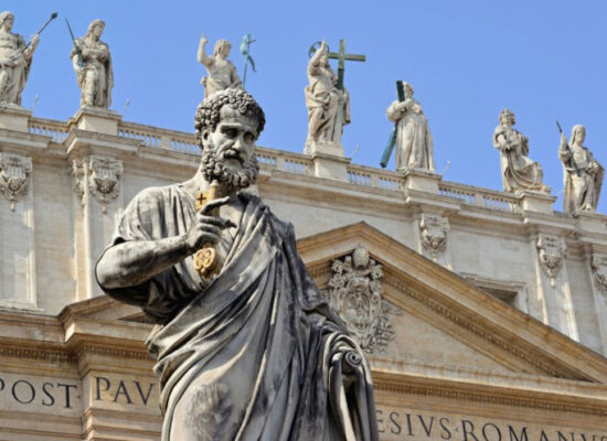 St. Peter and Statues of Jesus and the Apostles on top of St. Peter's Basilica