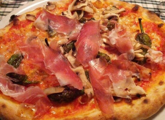 Tirolese - tomato sauce, mozzarella, speck (smoked, cured ham)